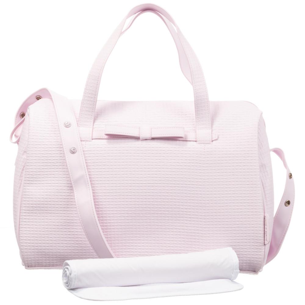 حقيبة يد باللون الزهري من ماركة Pasito A Pasito من دوها