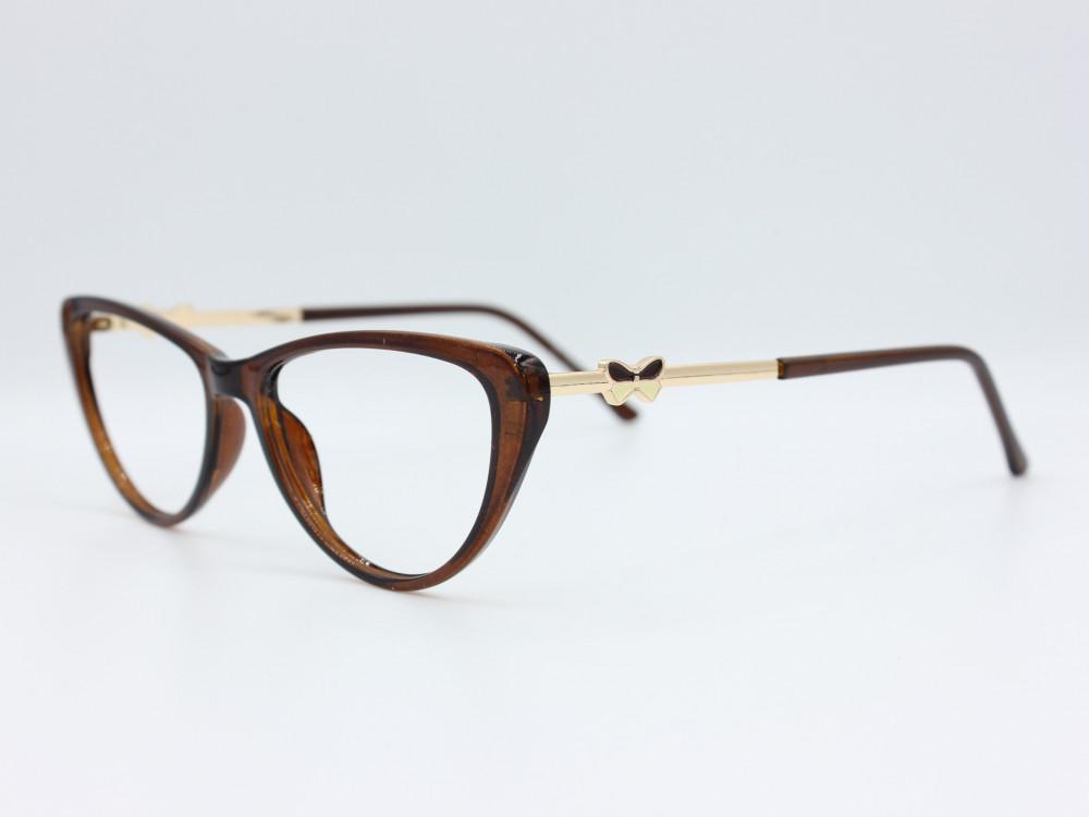 نظارة طبية نسائيه من ماركة T بيضاوي مع عدسات بحماية لون الاطار بني و ذ