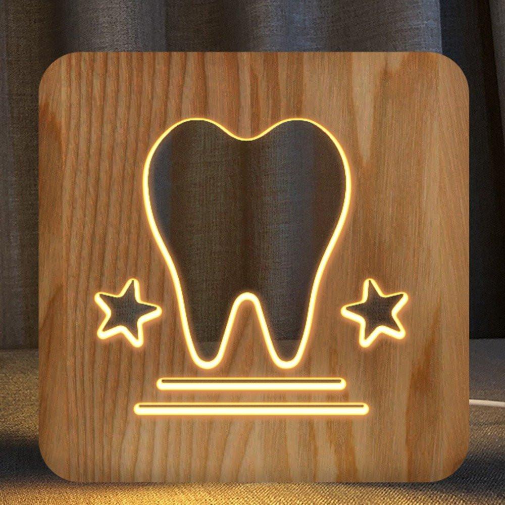 مواسم تحفة فنية خشبية ومضيئة بشكل سن بتصميم فريد و ثلاثي الأبعاد