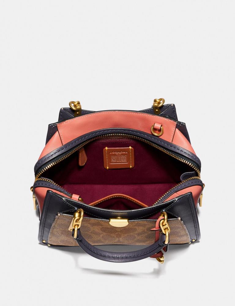 حقيبة يد انيقة بالوان زاهية من كوتش