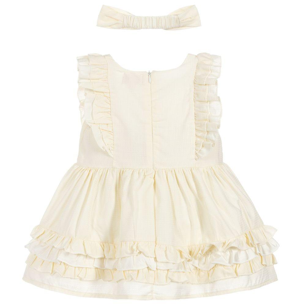 فستان باللون الاصفر مع ربطة شعر من ماركة CARAMELO من دوها