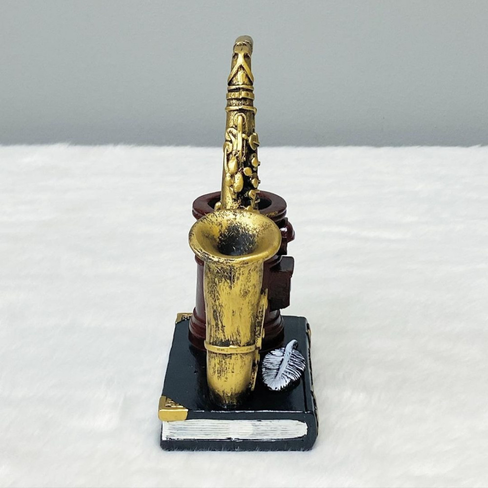 ديكور قاعدة أقلام شكل ساكسفون مع كتاب سيراميك تحف وهدايا ديكور منزلي