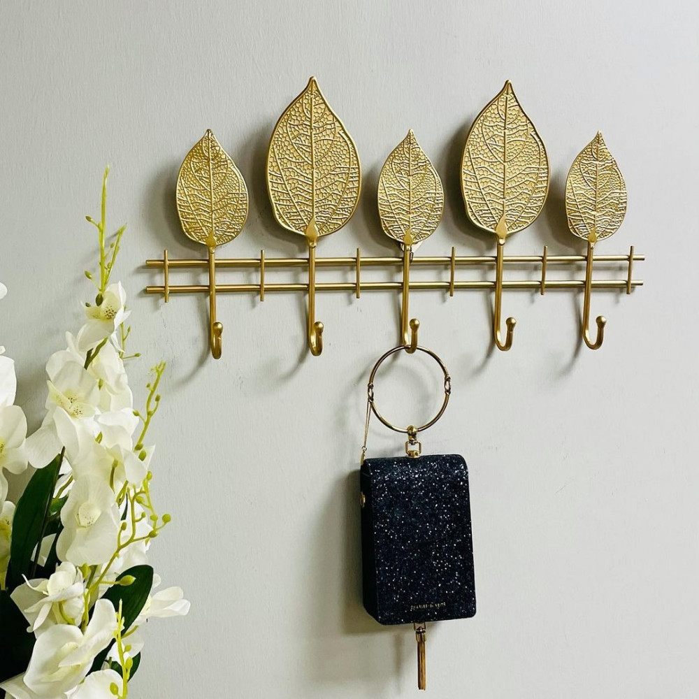 تعليقة ملابس وعبايات حديد ذهبي ورقات تعليقات جدارية ديكورات المنزل
