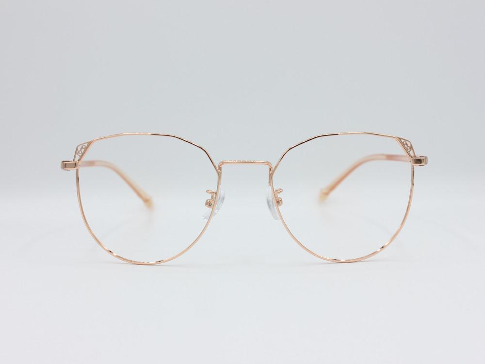 نظارة طبية نسائية من ماركة T دائريه مع عدسات بحماية لون الاطار ذهبي
