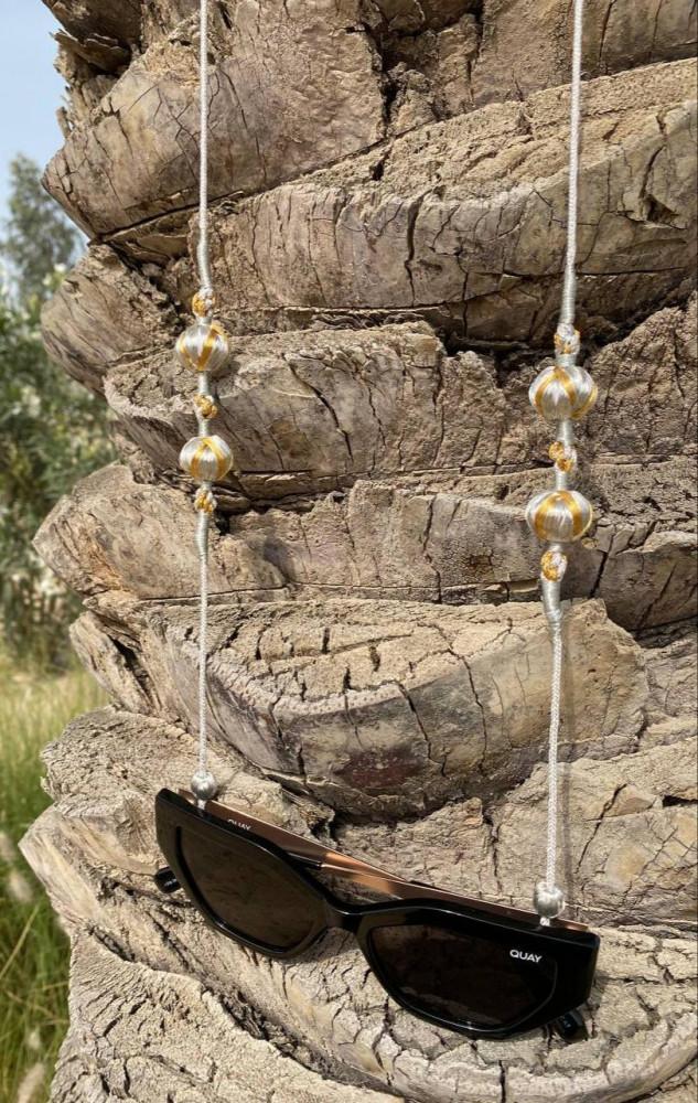 حامل نظارة مستوحى من المشلح الأحسائي الملكي صنع يدويا من خيوط الزري