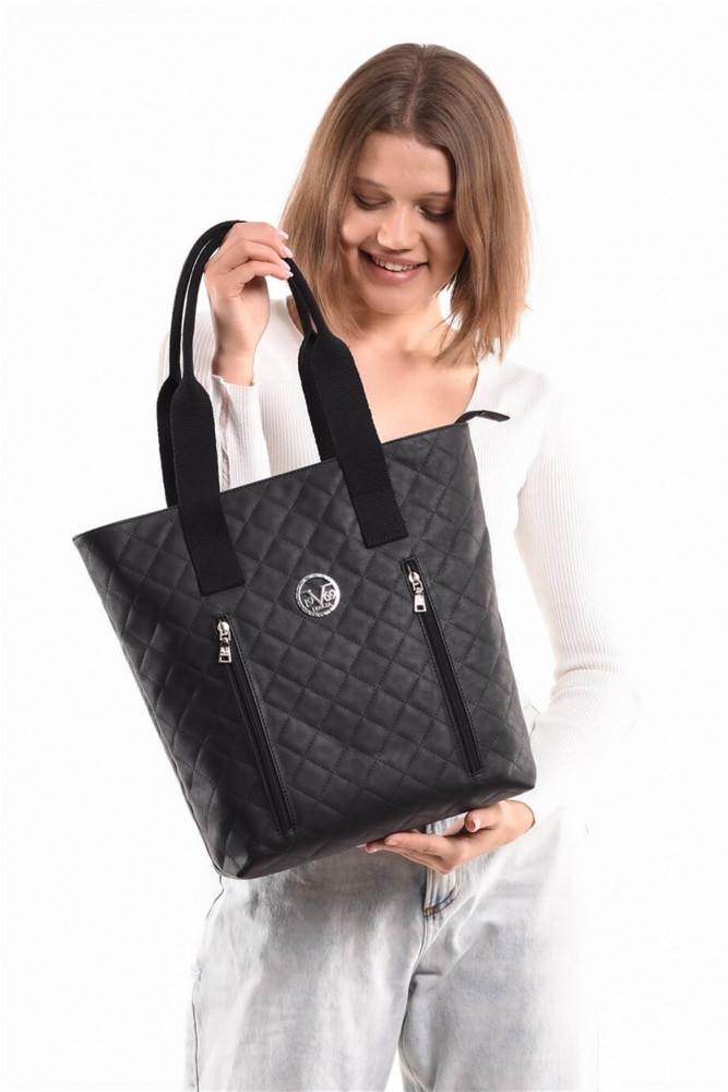 حقيبة سوداء موحدة اللون نسائية