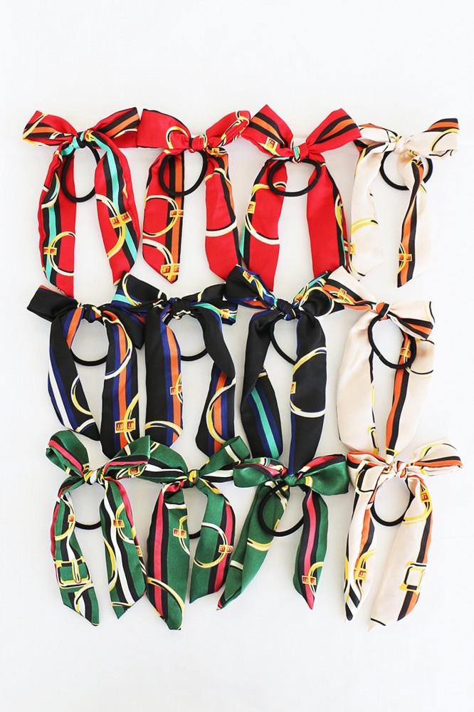 توكة شعر مرنة متعددة الألوان بشكل فيونكة - 12 قطعة