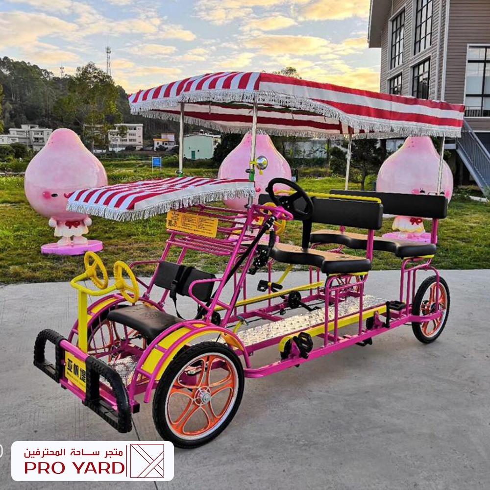 دراجة عائلية 6 راكب 4 كبار 2 صغار لون زهري