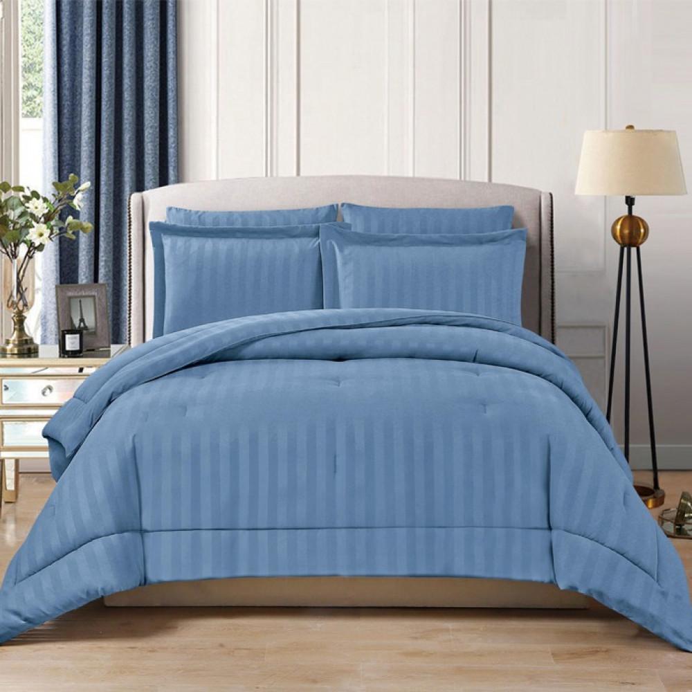 مفرش لون أزرق الفندقي بتصميمه المخطط وألوانه المتعددة