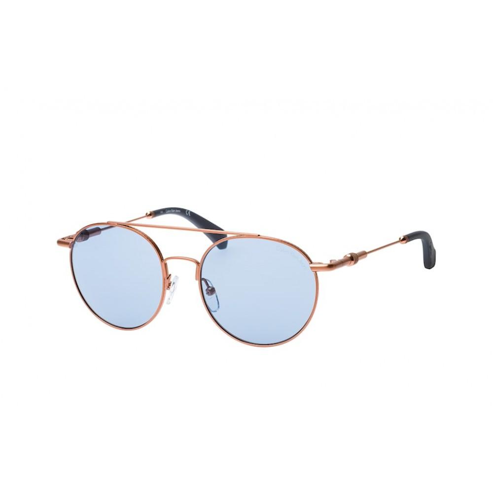 نظارات كالفن كلاين الشمسيه للجنسين - شكل دائري - لون ذهبي - زكي