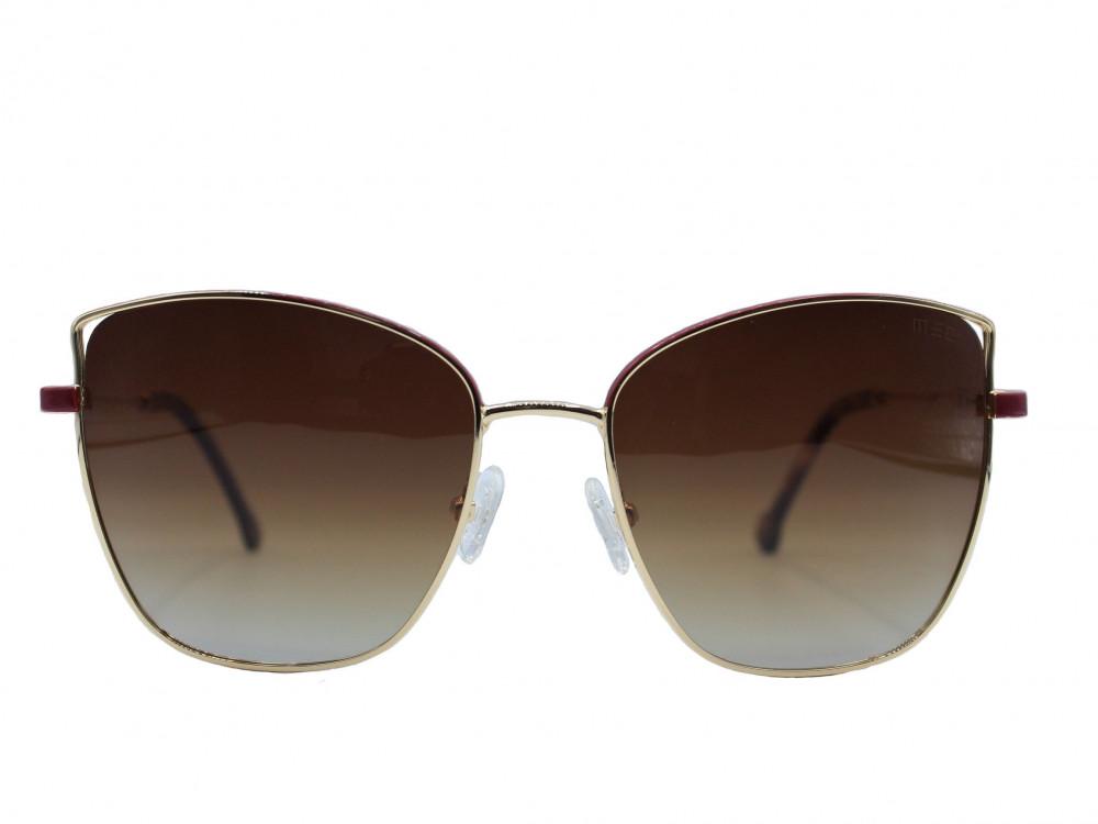 نظارة شمسية ماركة MECنسائية لون العدسة اسود مدرج لون الإطار ذهبي عنابي