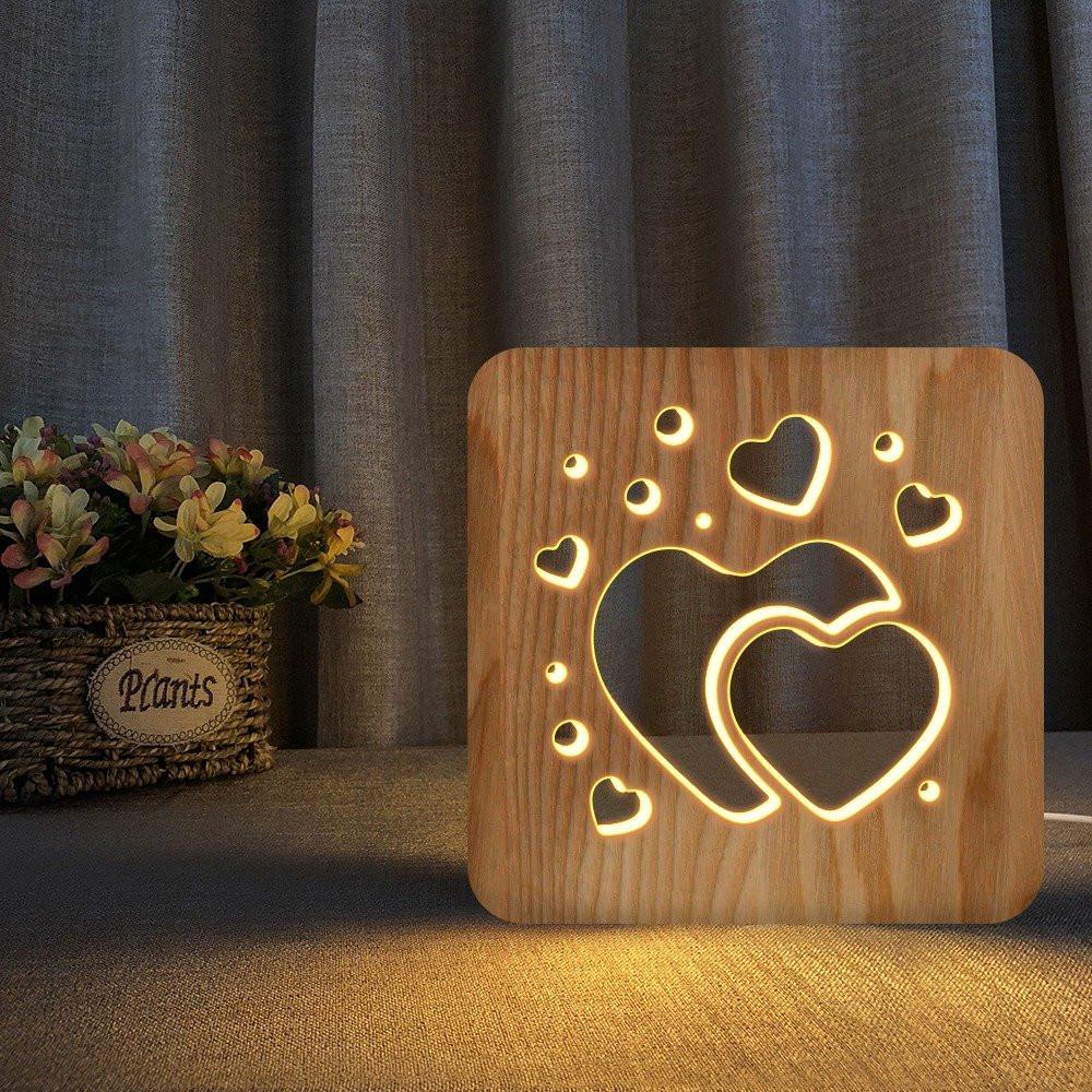 مواسم تحفة فنية خشبية شكل قلبين تضيف الطابع الجذاب للمنزل أو المكتب