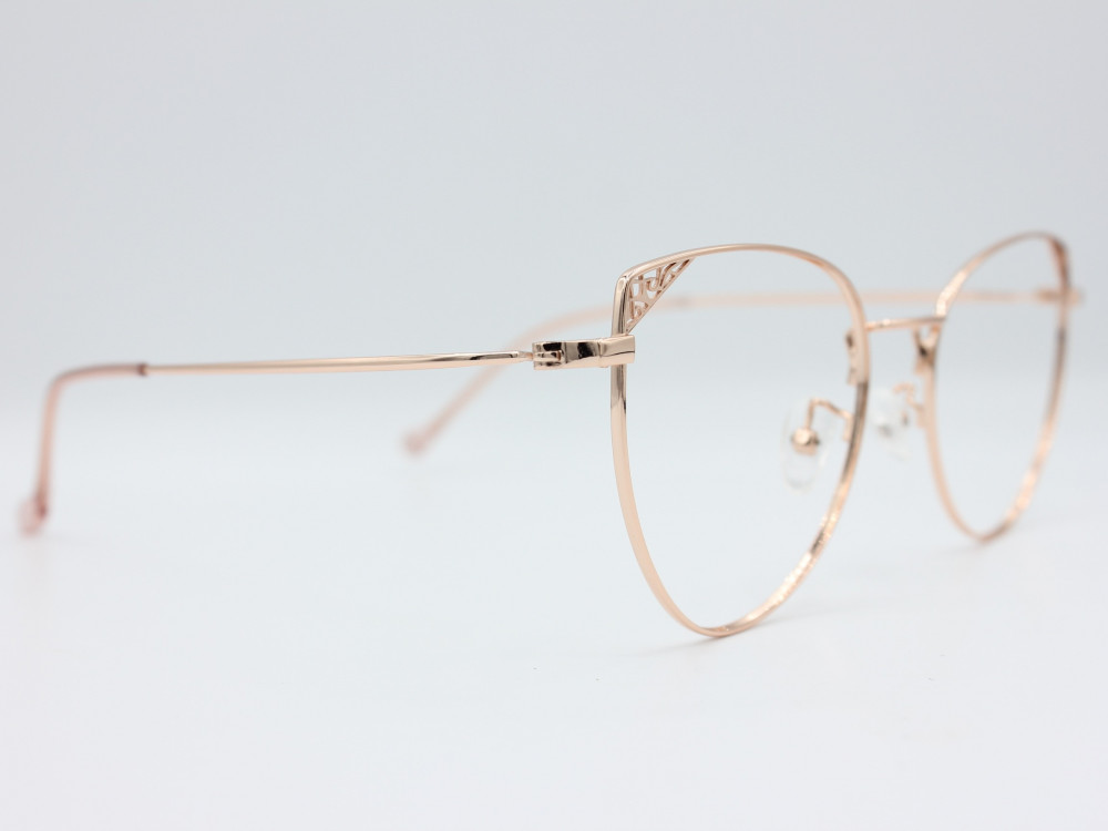 نظارة طبية نسائية من ماركة T كلاسيك مع عدسات بحماية لون الاطار ذهبي
