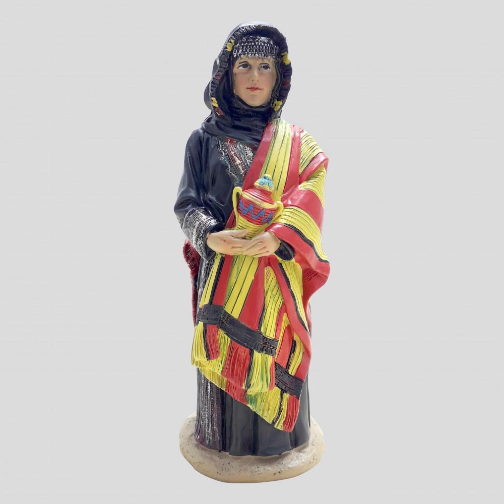 إمرأة من الجنوب بلباس الزي الجنوبي التقليدي
