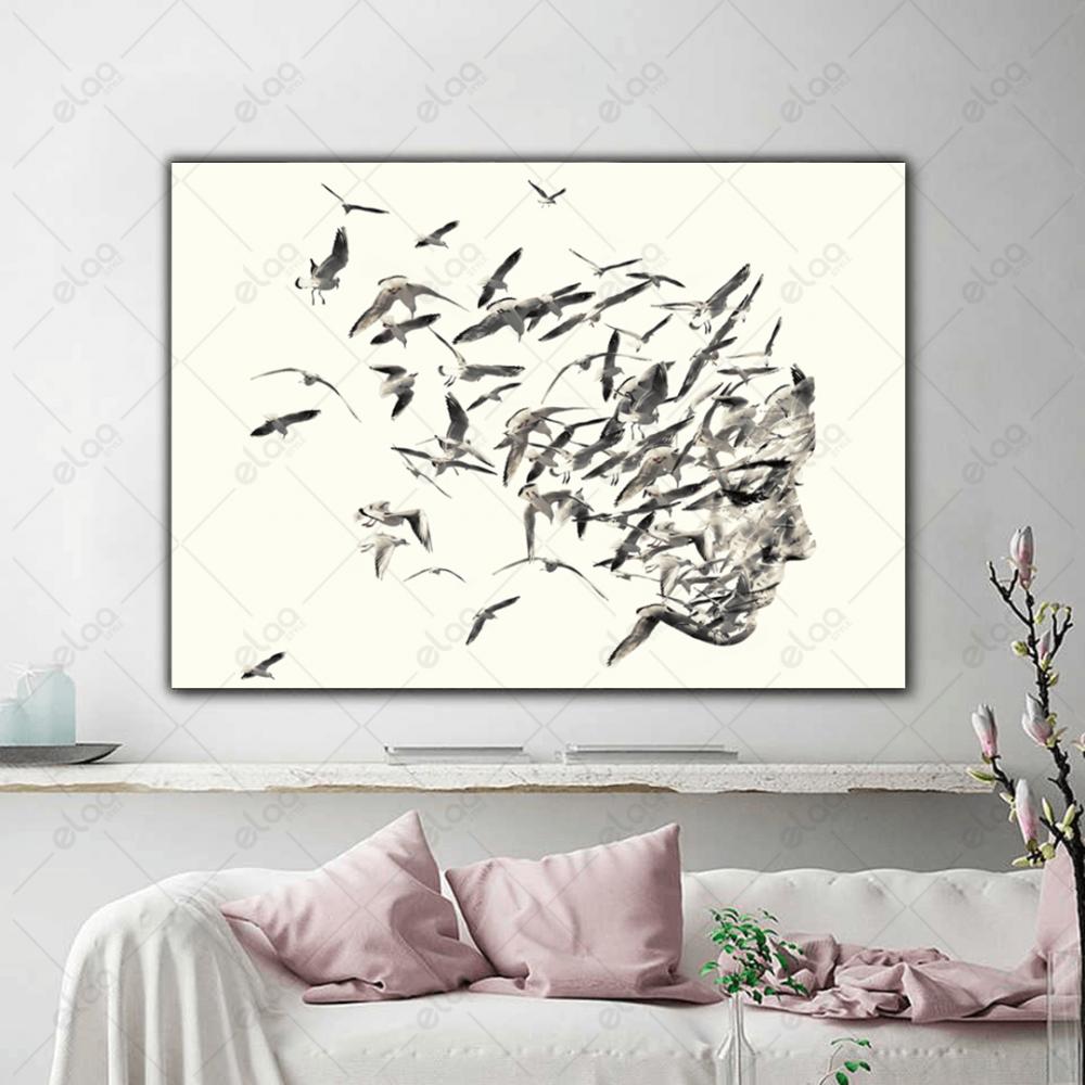 لوحة فنية لوجه امراة مكونة من مجموعة طيور