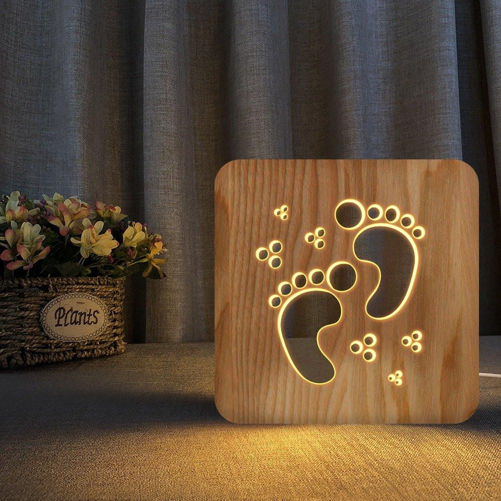 مواسم تحفة فنية مضيئة مصنوعة من الخشب شكل بصمة القدم باللون الخشبي