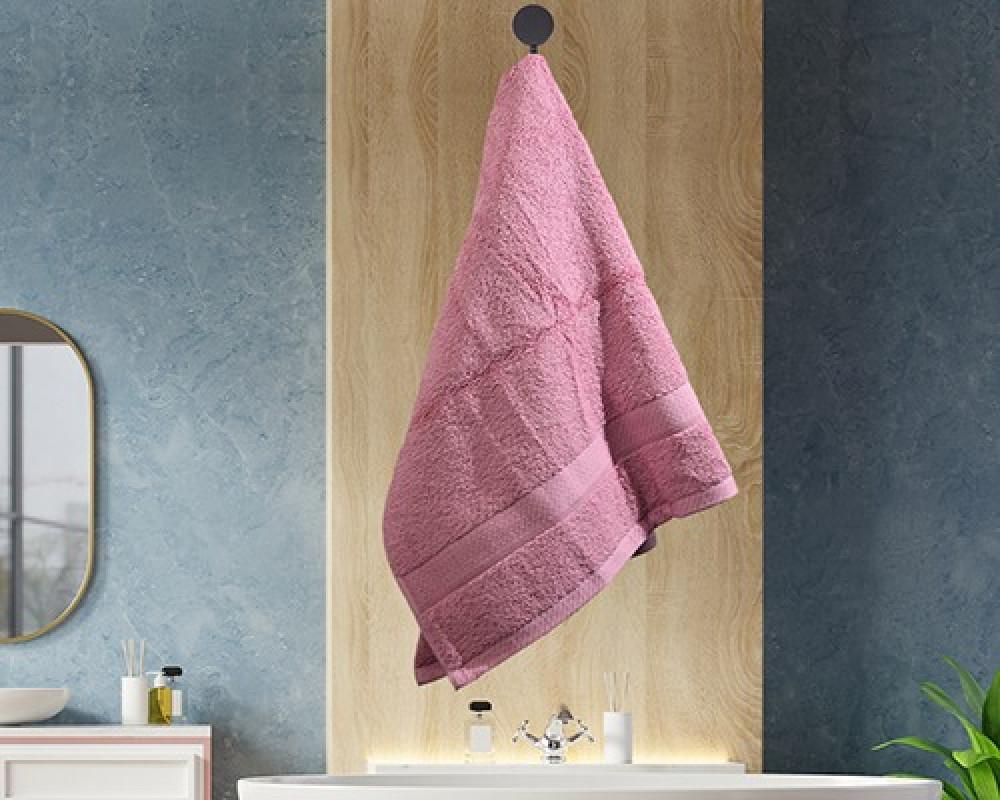منشفة ضيوف لونها وردي غامق تستخدم للوجه او اليدين