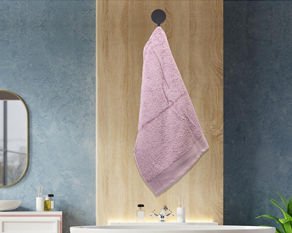 منشفة ضيوف لونها وردي تستخدم للوجه او اليدين