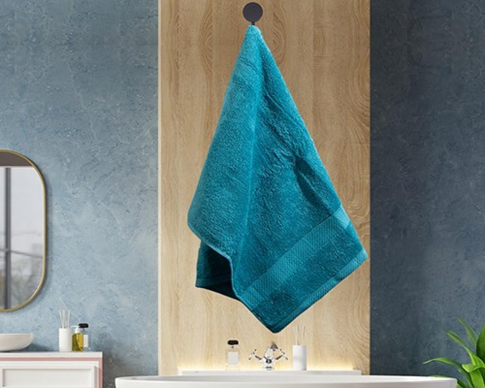 منشفة ضيوف لونها تركواز تستخدم للوجه او اليدين