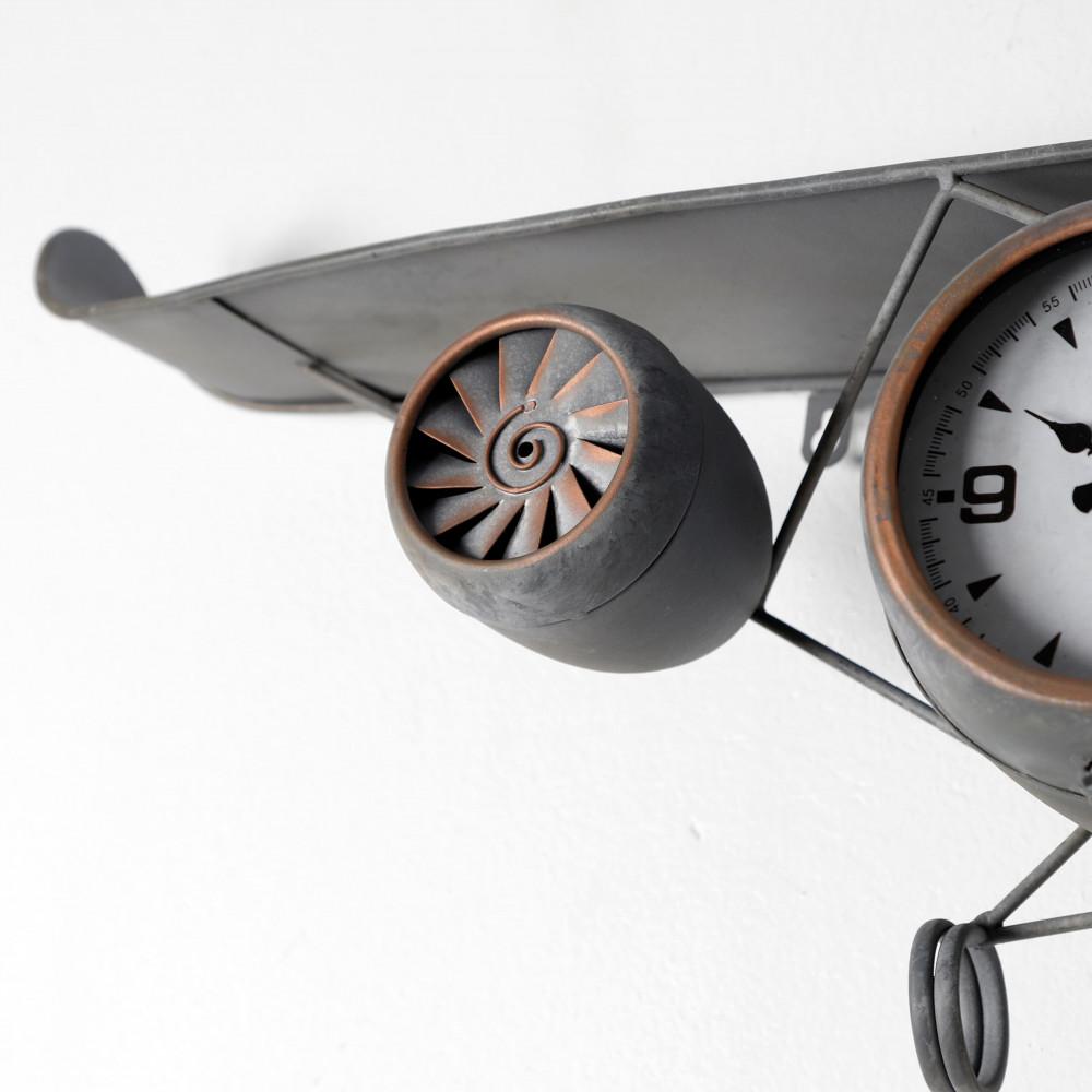 صورة تصميم ساعة حائط أنتيكة موديل بلان ايت شكل طائرة صناعة معدنية