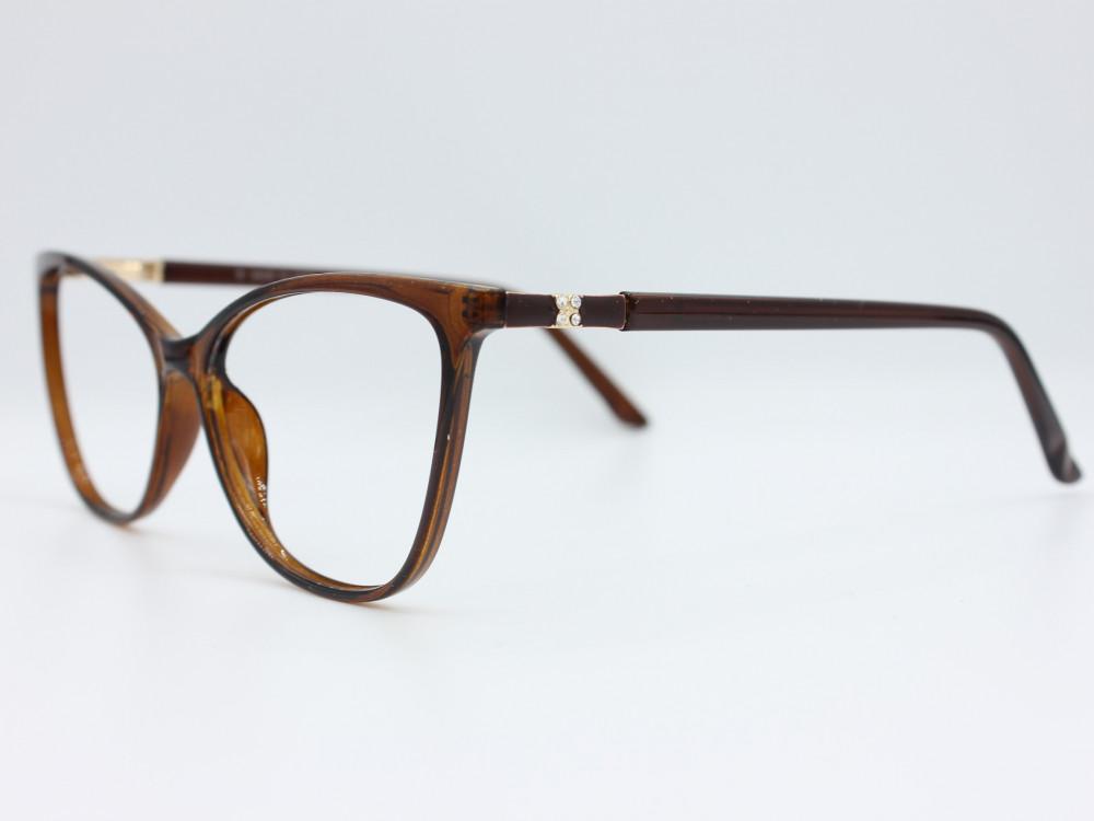 نظارة طبية نسائية من ماركة T بيضاوي مع عدسات بحماية لون الاطار بني