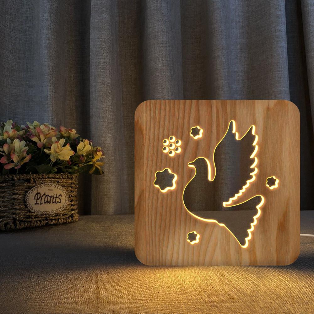 مواسم تحفة فنية مضيئة خشبية شكل الطائر مصنوعة من الخشب  وذات لون خشبي